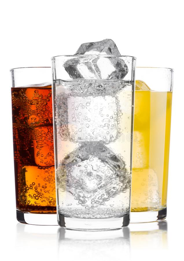 Glasses of cola and orange soda drink and lemonade stock photos