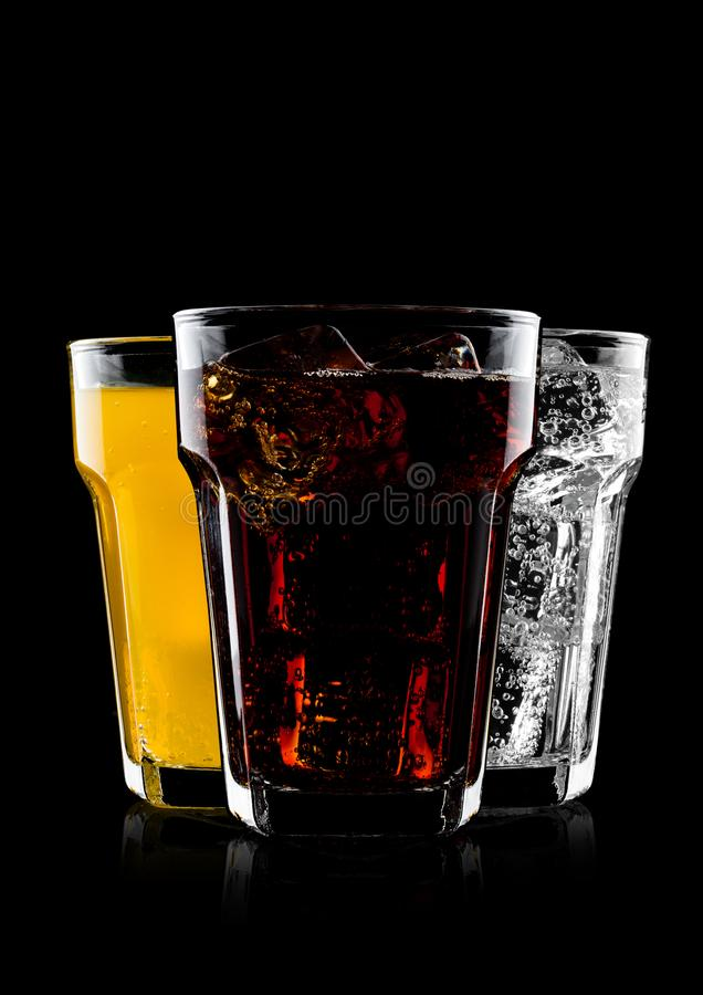 Glasses of cola and orange soda drink and lemonade stock image