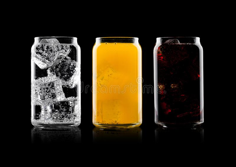 Glasses of cola and orange soda drink and lemonade royalty free stock image
