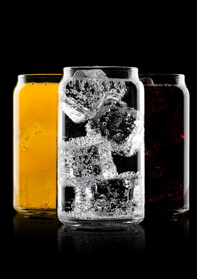 Glasses of cola and orange soda drink and lemonade royalty free stock images