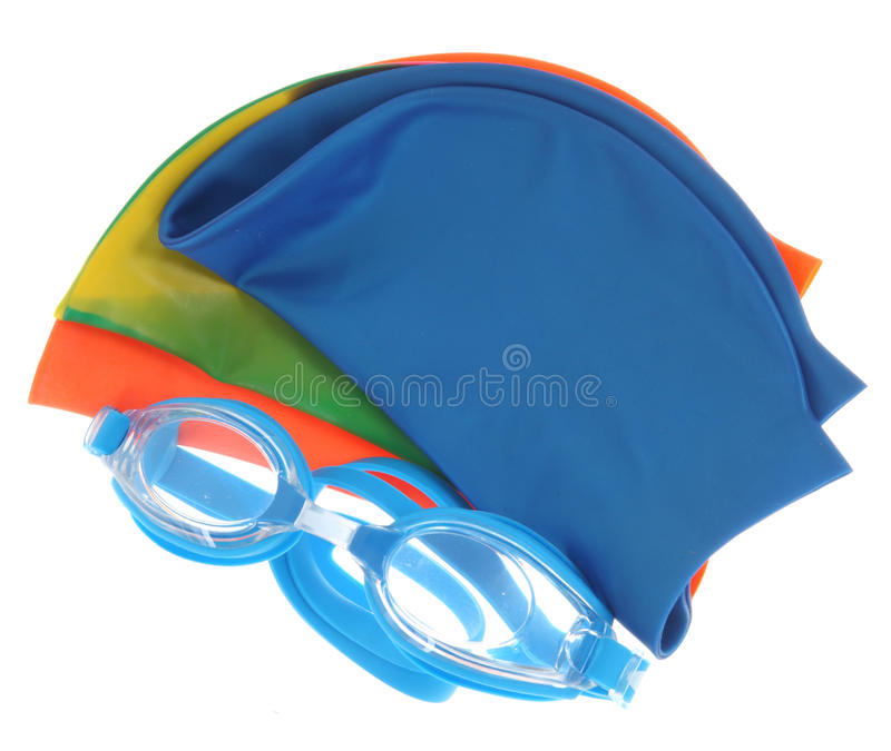 Glasses and color caps for swimming royalty free stock image