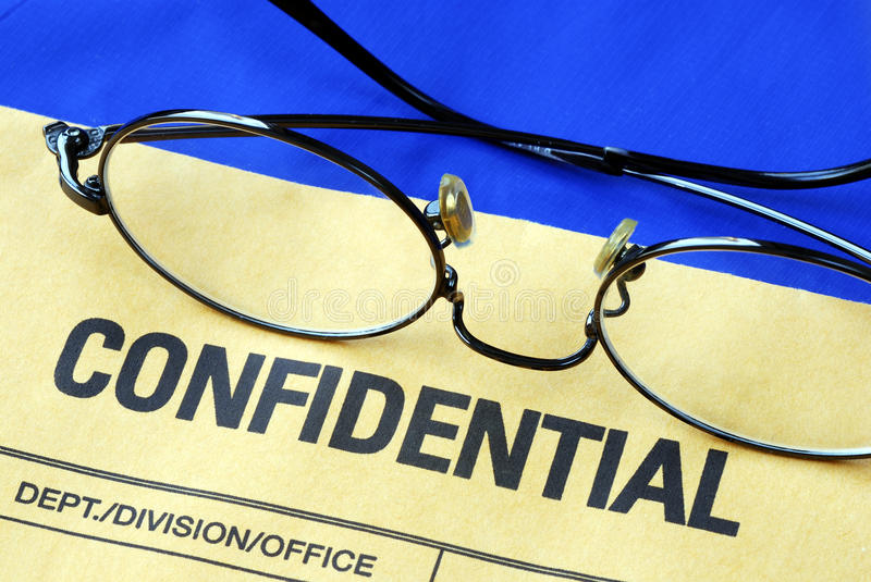 Glasses on the confidential envelope stock images