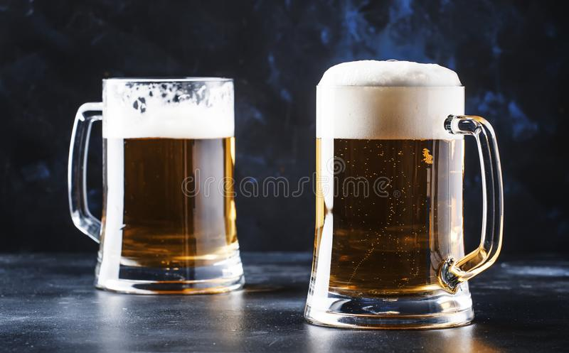 Glasses with czech light beer, dark bar counter, selective focus stock image
