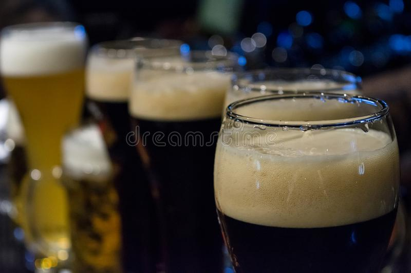 Glasses of dark beer close up image stock image