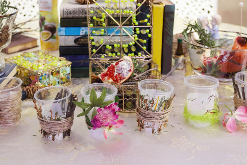 Glasses with decoration flowers and branches and books stock photo