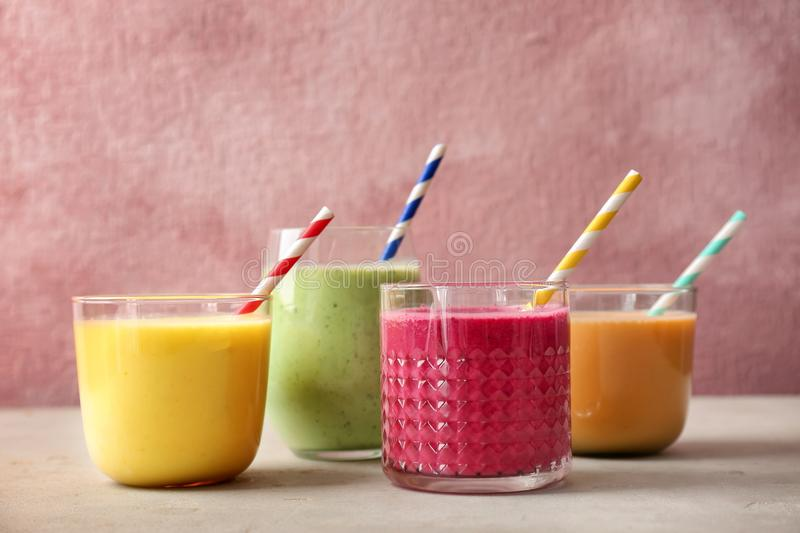 Glasses with delicious detox smoothies. On table stock images