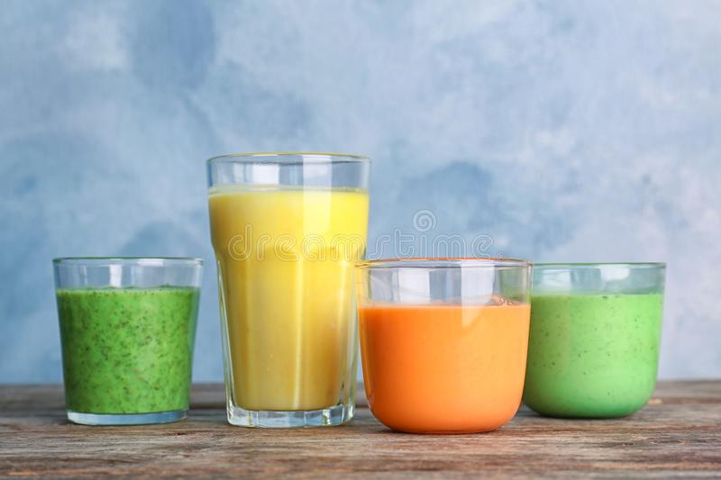 Glasses with delicious detox smoothies. On table stock photos