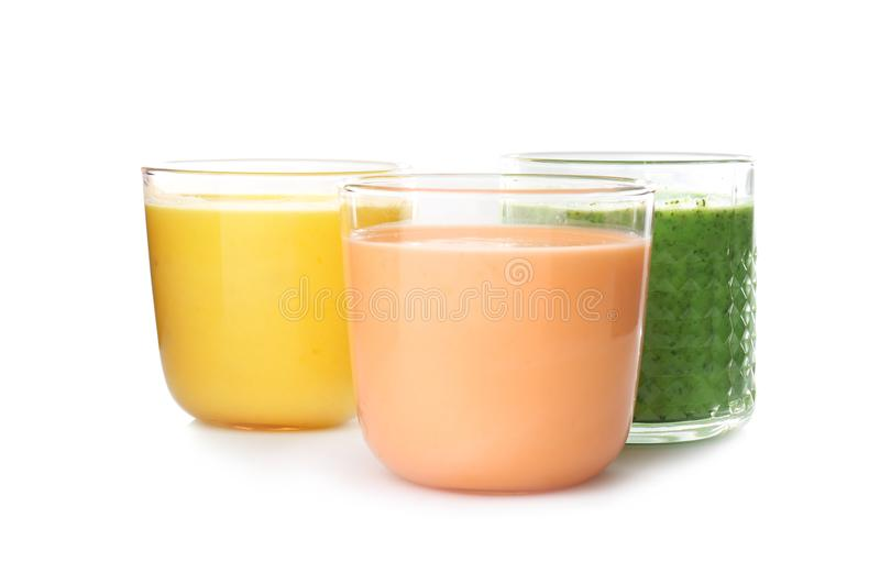 Glasses with delicious detox smoothies. On white background stock image