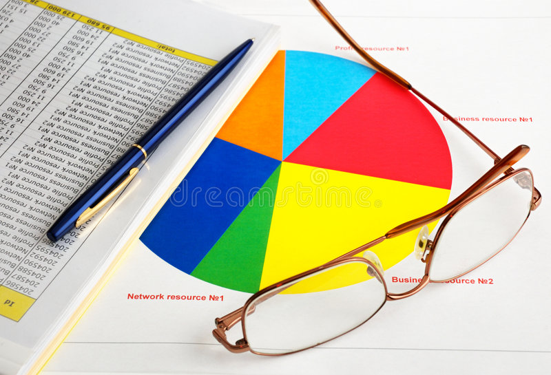 Glasses and diagram. (concept of the analysis stock photos