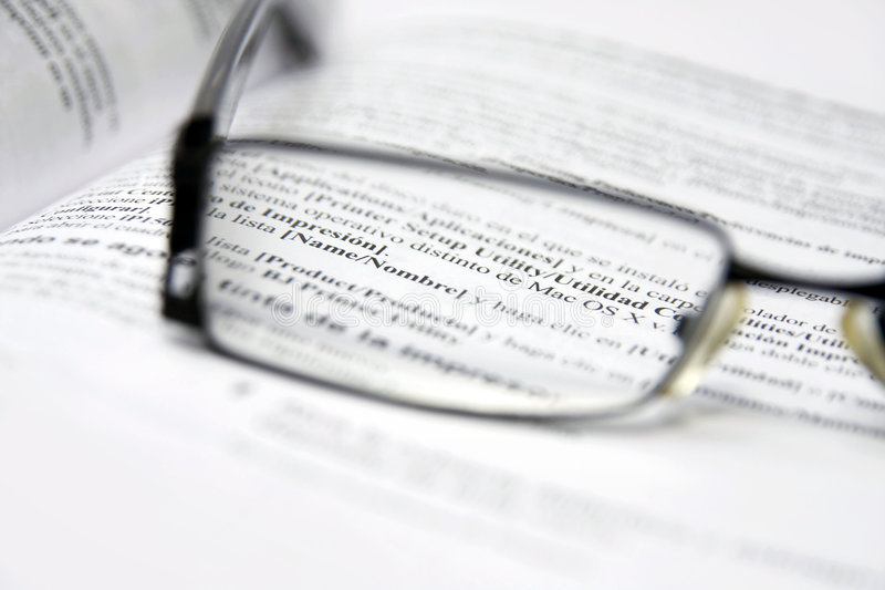 Glasses on dictionary stock images