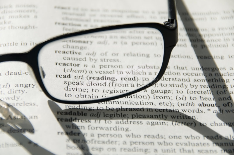 Glasses on dictionary, detail royalty free stock image