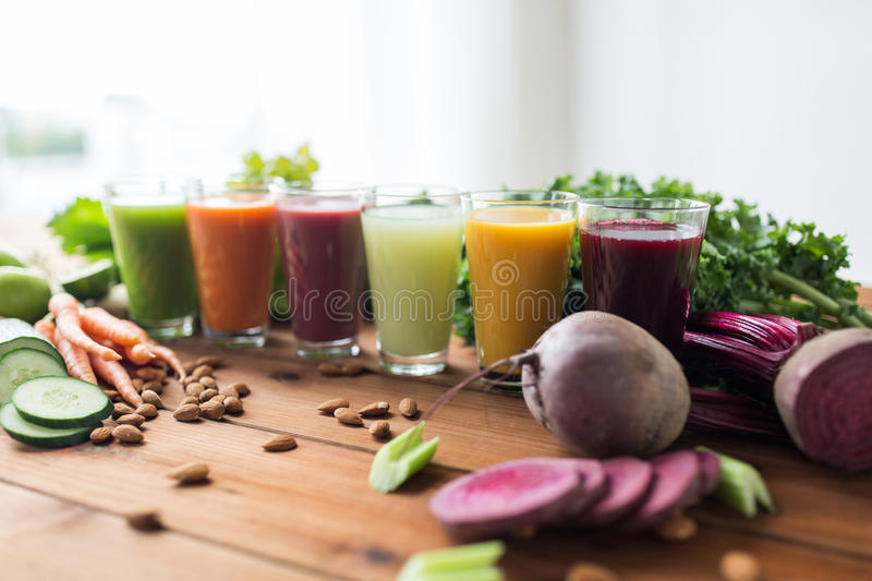 Glasses with different fruit or vegetable juices royalty free stock images