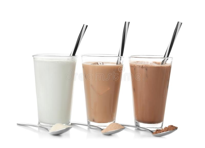 Glasses with different protein shakes and powders royalty free stock image
