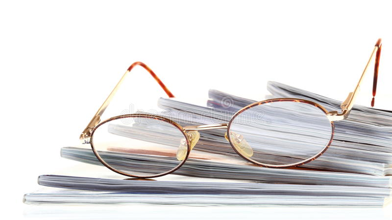 Glasses eBook reader isolated on white stock photography