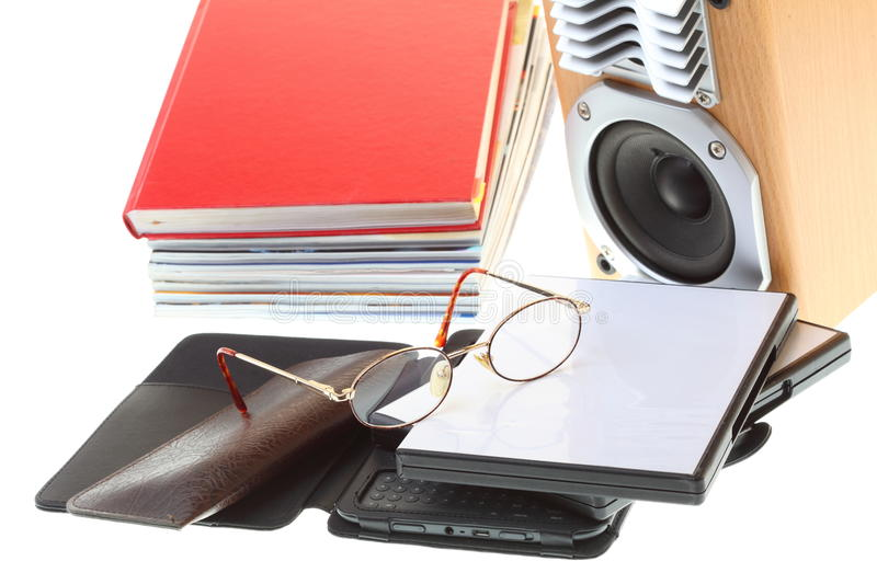 Glasses eBook reader pile of books, isolated on white stock images
