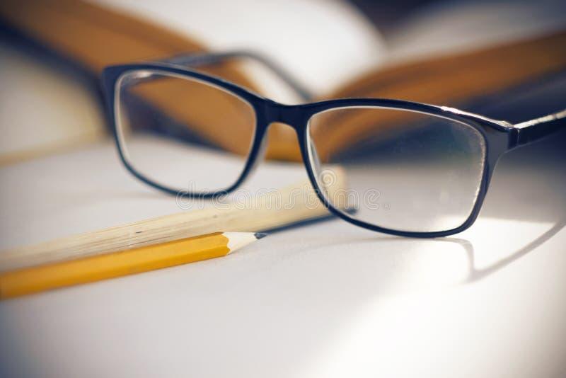 Glasses in elegant black frames illuminates the sunlight stock images