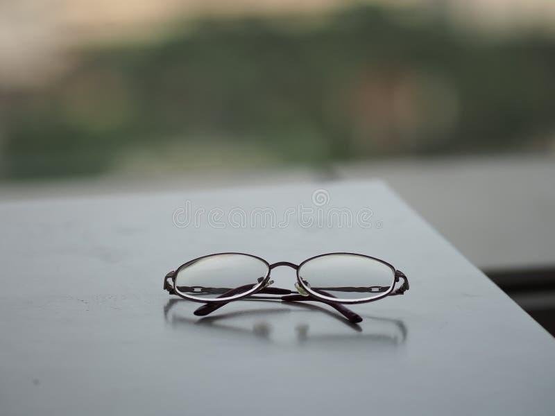 Glasses eyewear on the white desk. Closeup clear glasses eyewear Black frame on the white desk stock images
