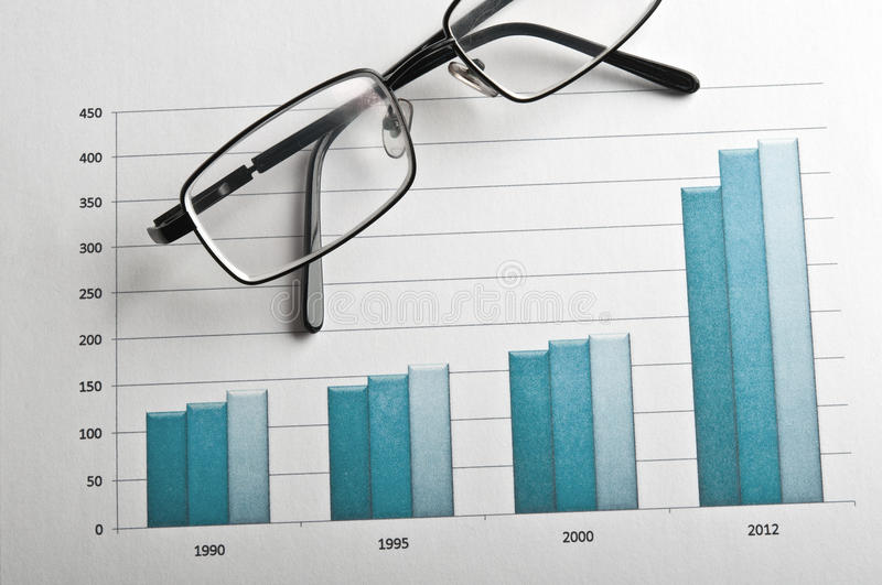 Glasses and financial growth chart. On the table in the office stock photography