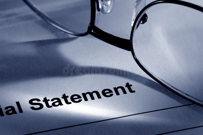 Glasses on Financial Institution Statement Page stock image