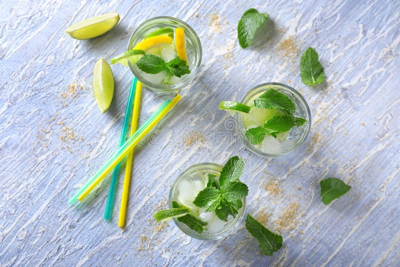 Glasses of fresh mojito on light table stock photo