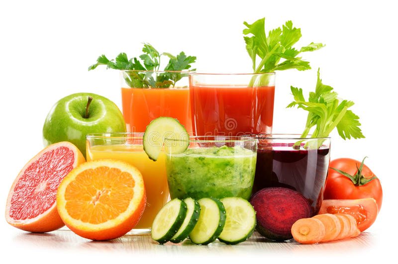 Glasses with fresh organic vegetable and fruit juices on white royalty free stock photos