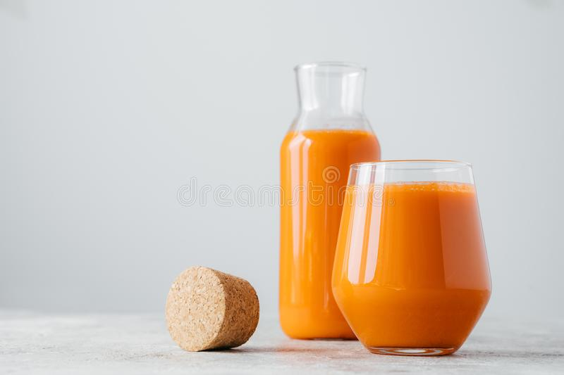 Glasses of fresh pressed carrot juice on white background. Homemade beverage for your healthy drink. Delicious drink full of royalty free stock images