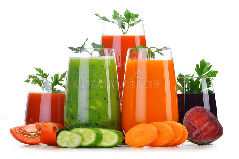 Glasses with fresh vegetable juices on white stock image