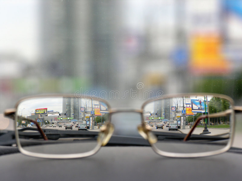 Glasses on front panels of car stock photography