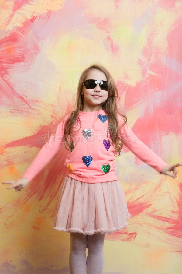 Glasses on girl kid with happy face. Small girl in fashionable summer glasses. Child girl on colorful background. beauty and fashion. Childhood and happiness royalty free stock photography