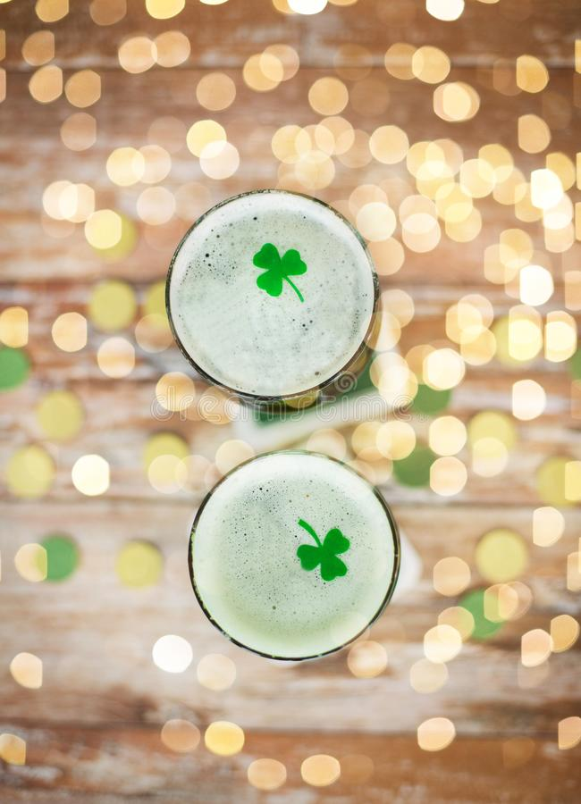 Glasses of green beer with shamrock from top stock photo
