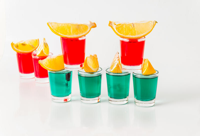 Glasses with green and red kamikaze, glamorous drinks, mixed drink poured into shot glasses. Party set royalty free stock photos