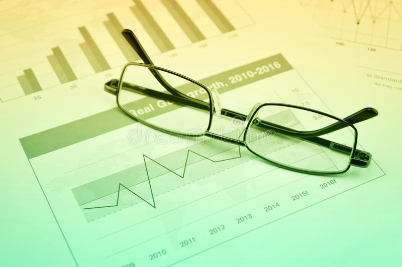 Business vision and success concept. Glasses on growth financial chart and graph, Business vision and success concept stock photo