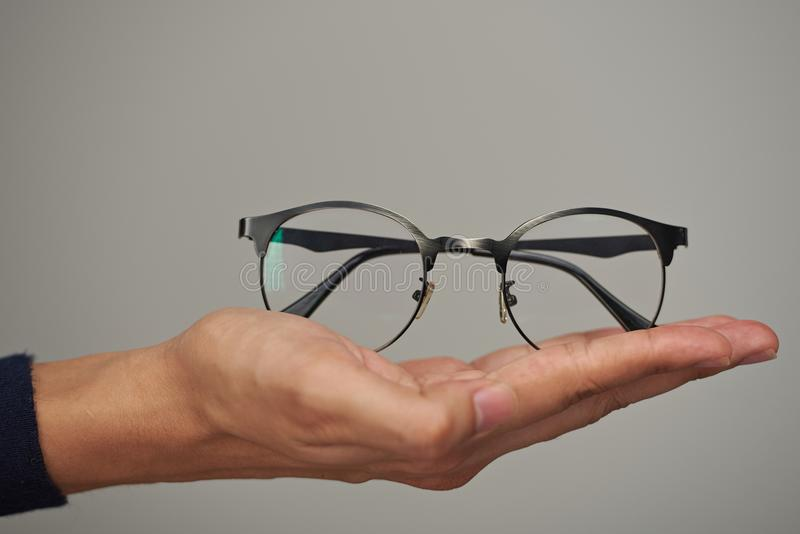 Glasses on human hand royalty free stock photography