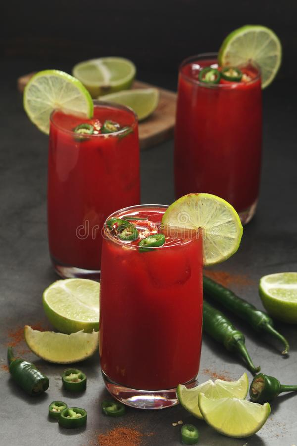 Jalapeno tomato margarita cocktail with lime stock images