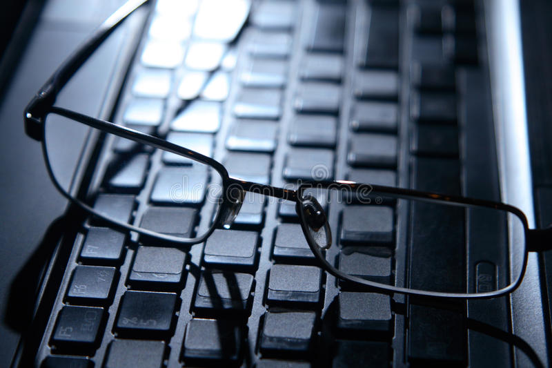 Download Glasses on the laptop. stock photo. Image of backgrounds - 24358828