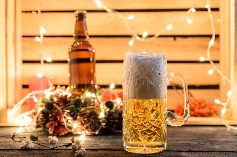 Glasses of light beer on a pub background royalty free stock image