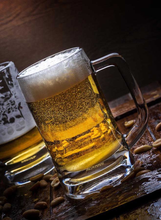 Glasses of light and dark beer stock photos