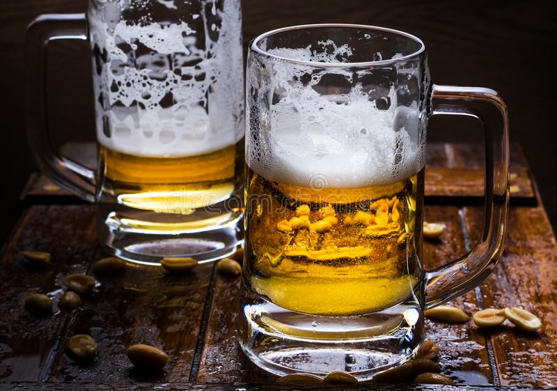 Glasses of light and dark beer royalty free stock photography