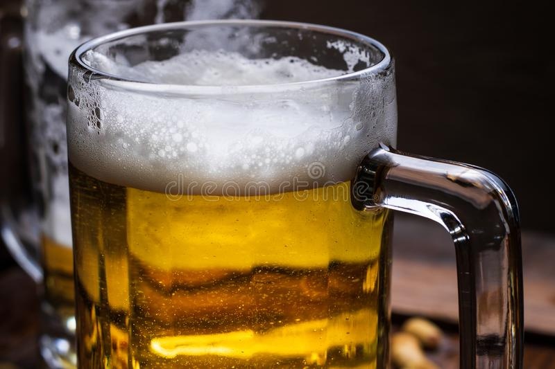 Glasses of light and dark beer stock photography