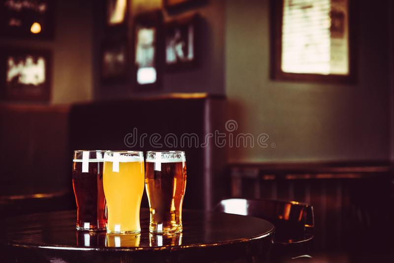 Glasses of light and dark beer on a pub background royalty free stock photo