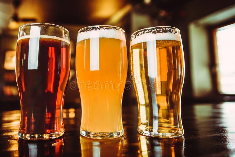 Glasses of light and dark beer on a pub background.  stock images