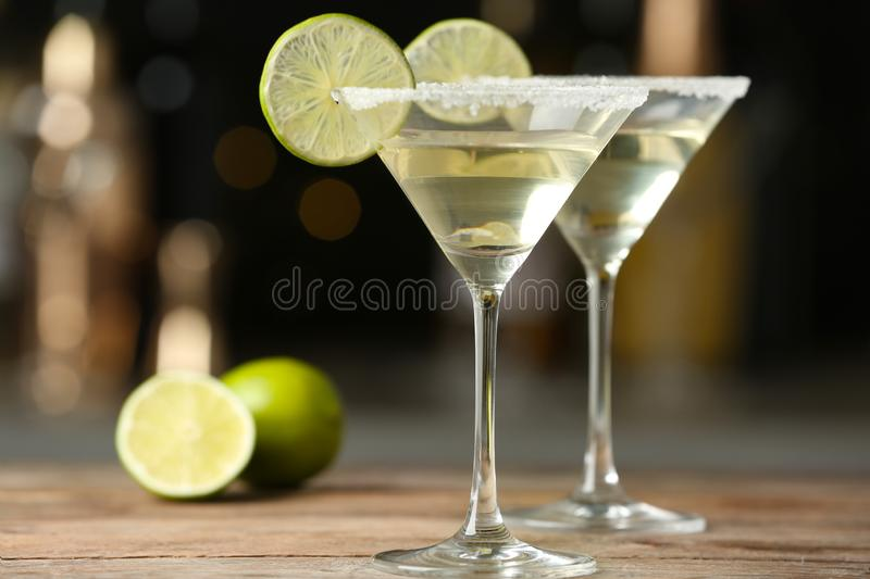 Glasses of Lime Drop Martini cocktail on wooden table royalty free stock photo