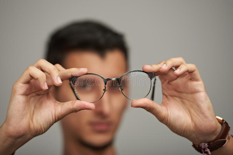 Glasses on man hands royalty free stock image