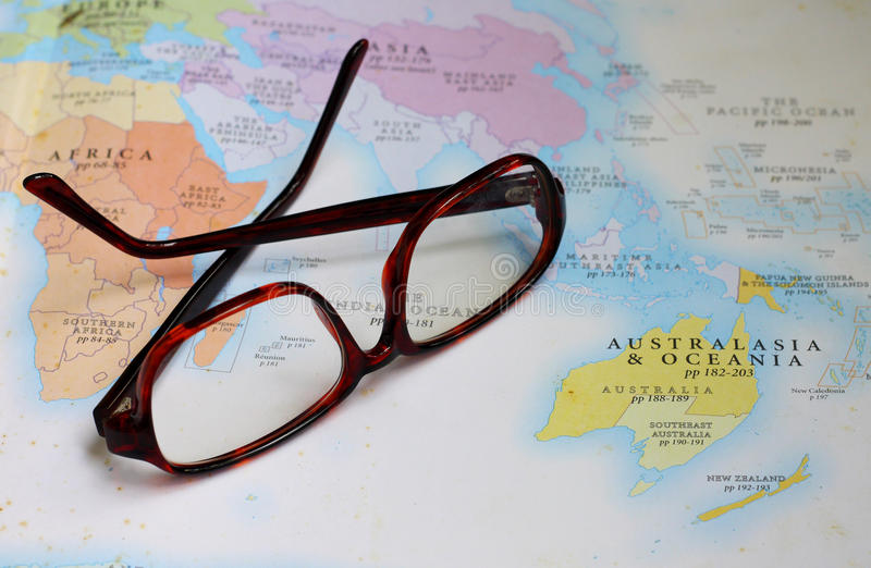 Glasses On Map Stock Photos