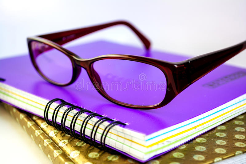 Glasses on notebooks royalty free stock photo