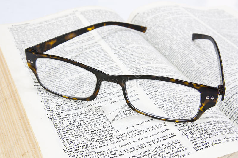 Glasses on open book royalty free stock photography