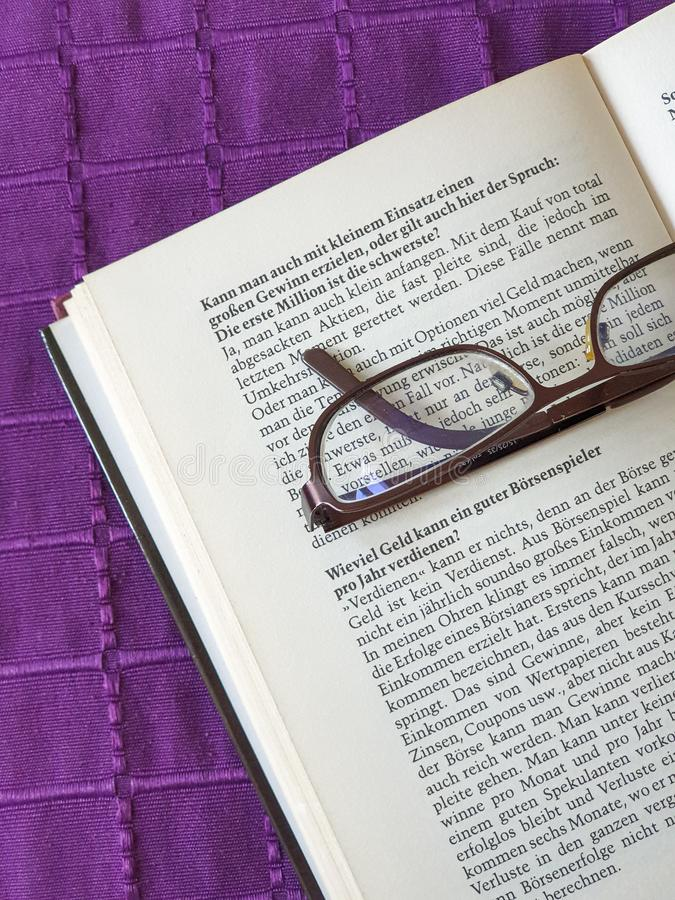 Glasses on open book. Reading, education, page, paper, dictionary, literature, library, business, study, spectacles, white, text, grass, school, learn, books royalty free stock images