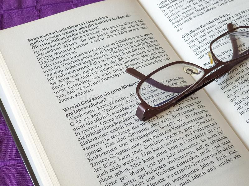 Glasses on open book. Reading, education, page, paper, dictionary, literature, library, business, study, spectacles, white, text, school, learn royalty free stock photos