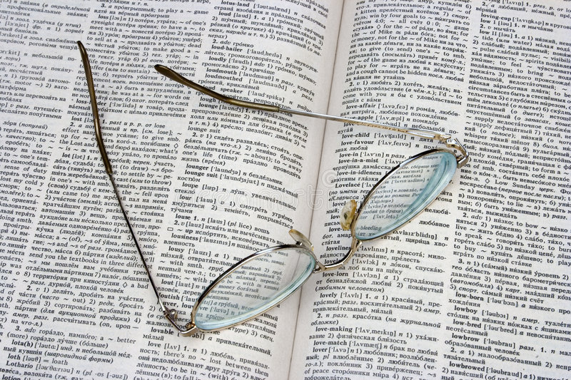 Glasses on opened book. (dictionary royalty free stock images