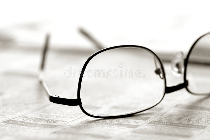 Download Glasses Over Newspaper Classified Section Stock Photo - Image: 7124782